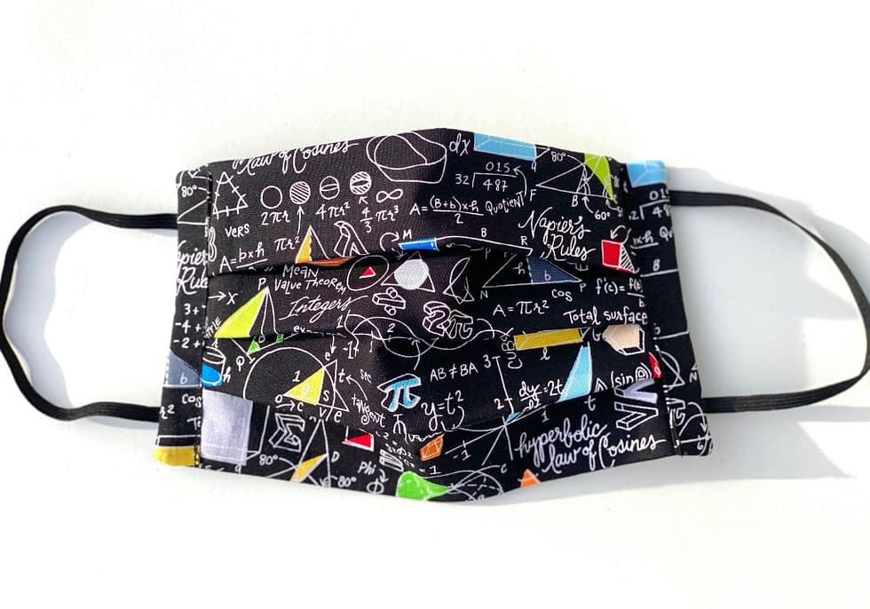 Equations Mask | black fabric with white handwritten font of various equations and colourful geometric shapes