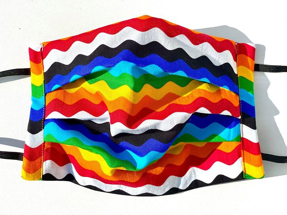 Rainbow Ric Rac Mask Closeup | closeup of multicoloured fabric mask in wavy ric rac style lines