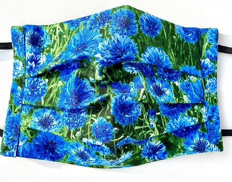 Cornflower Meadow Mask Closeup | closeup of fabric with grass background with realistic images of cornflowers