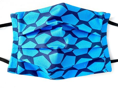 Pentagons Mask Closeup | closeup of dark blue fabric with light blue pentagons shapes