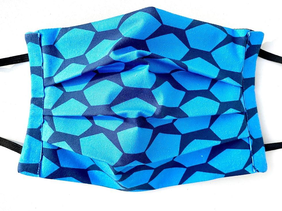 Pentagons Mask Closeup   closeup of dark blue fabric with light blue pentagons shapes