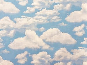 Light blue fabric with fluffy white clouds