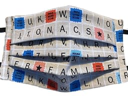Cream Fabric with pattern of scrabble tiles and board
