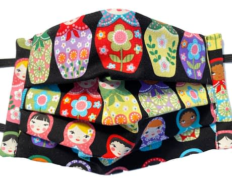 Black fabric with multicoloured pattern of Matryoshka dolls
