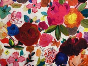white fabric with colourful flowers pattern of varying sizes and types