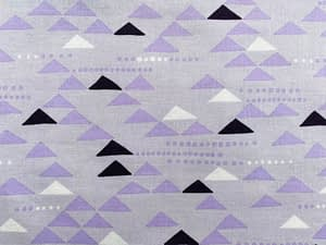 Lilac fabric with white, purple and black triangle shapes pattern