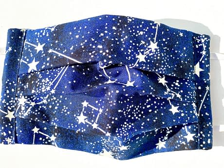 Glow in the Dark Constellations Mask Closeup | closeup of dark blue fabric with glow in the dark realistic constellations and background stars