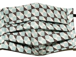 White fabric mask with brown and turquoise cuboid pattern