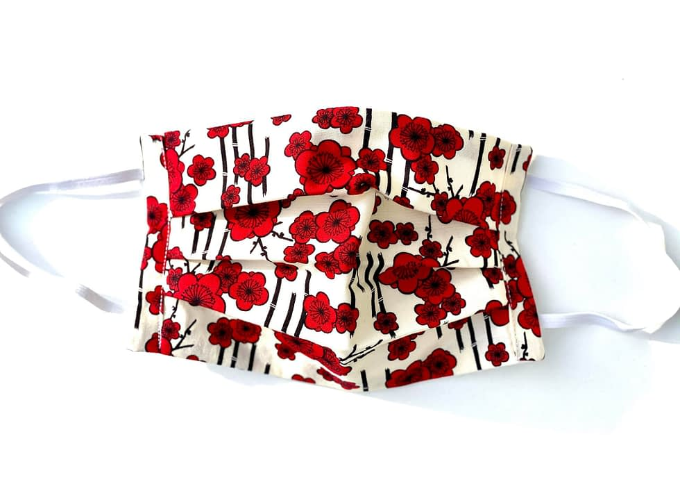Bamboo Poppies Mask | white fabric mask with illustrated red poppies and black bamboo in the background in a Japanese style