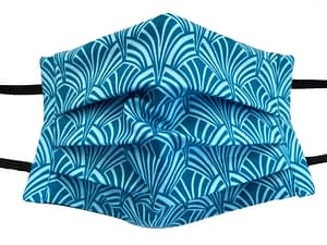 Turquoise fabric with ar deco style shaped pattern