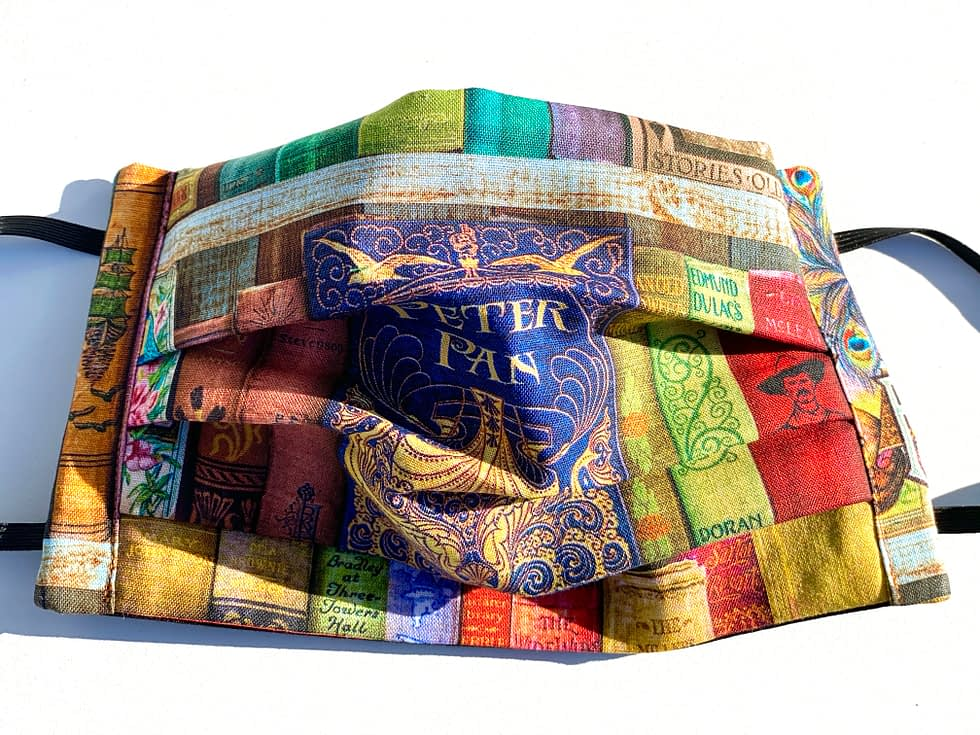 Classic Childrens' Books Mask | Closeup of fabric mask with image of shelves of classic childrens' books