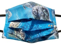 Blue fabric with undersea scene with various manatees