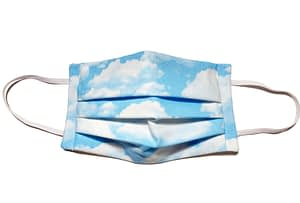 Longshot of mask with light blue fabric with fluffy white clouds
