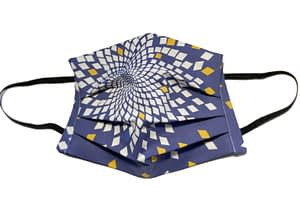 Dark blue fabric mask with fibonacci style pattern in a flower like shape with diamonds in white, yellow and light blue
