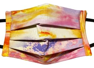 Sunset patterned fabric mask with a mix of golden, pink and purple colours