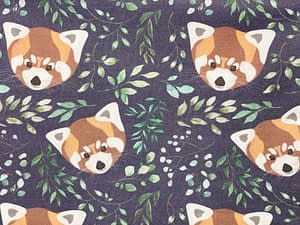 Dark fabric with red panda faces and green leaves pattern