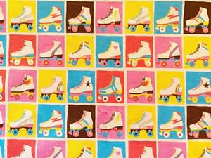 Multicoloured fabric with squares containing rollerskates in varying colours