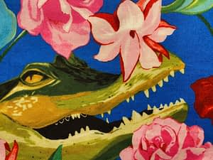 Blue fabric with large crocodile head and pink flowers