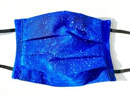 Starry Night Mask Closeup | closeup dark blue fabric with illustrated stars and lighter blues variation