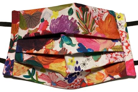 white fabric mask with colourful flowers pattern of varying sizes and types