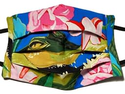 Blue fabric mask with large crocodile head and pink flowers