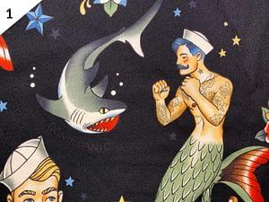 Black fabric mask with pattern of merman punching a shark