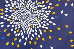 Dark blue fabric with fibonacci style pattern in a flower like shape with diamonds in white, yellow and light blue