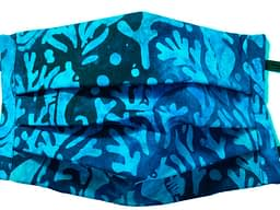 Dark blue fabric with batik pattern of seahorses and seaweed in turquoise