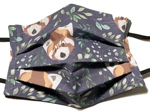 Dark fabric mask with red panda faces and green leaves pattern