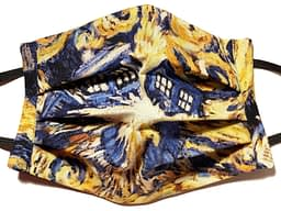 Navy and gold coloured fabric mask with swirls of the Tardis from Dr Who exploding