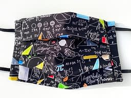 Equations Mask Closeup | closeup of black fabric with white handwritten font of various equations and colourful geometric shapes