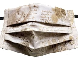 Parchment style fabric mask with DaVinci's handwriting notes on his inventions with drawings
