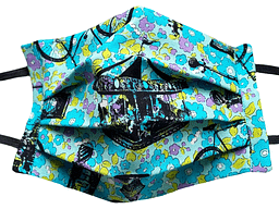 Turquoise and yellow flower fabric mask with black imprints of vintage stamps in pattern of cycles bottles and merry go round
