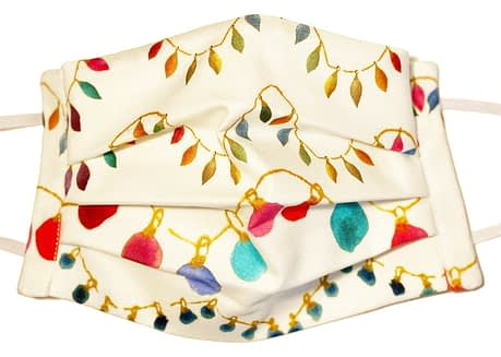 Closeup of mask with Light coloured fabric with strings of multicoloured party lights
