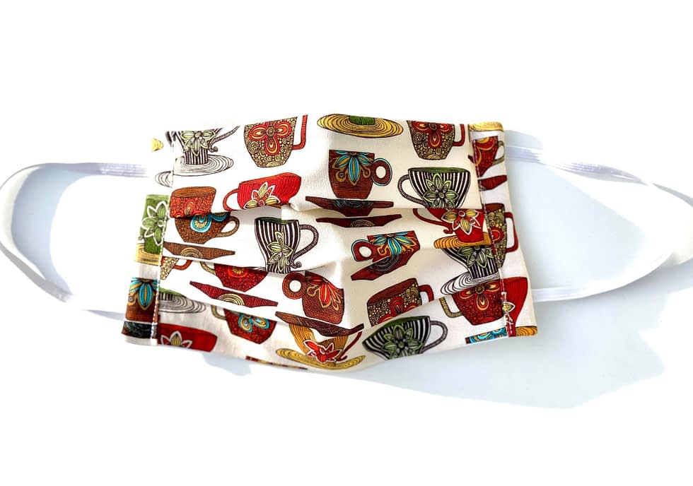 Teacups Mask | cream fabric with multicoloured teacups and saucers design