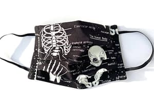 Glow in the Dark Skeletons Mask | black mask with glow in the dark white skeleton illustrations and labelled names of parts of human body