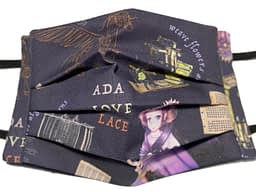 Ada Lovelace original design fabric mask with cartoon image of Ada plus her steam powered horse-plane and the Jacquard loom and Analytical Engine with quotes from her poetry and flowers and leaves made of her equations