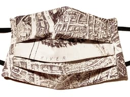 Cream fabric mask with a pattern in black of an antique map of London